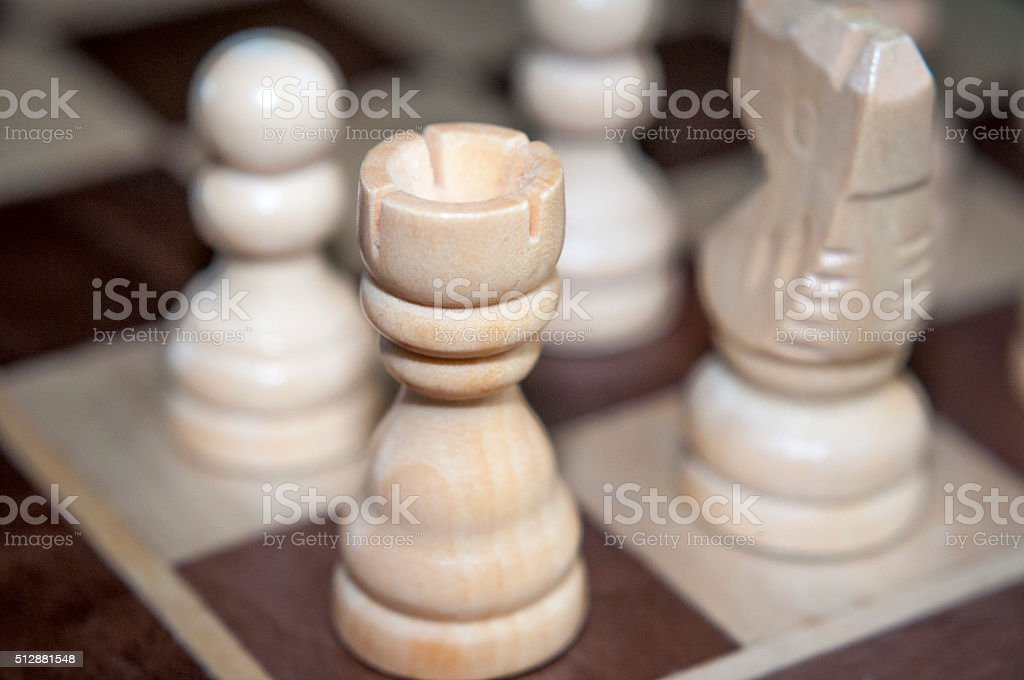 Wooden White Rook (Or Castle) Chess Piece stock photo