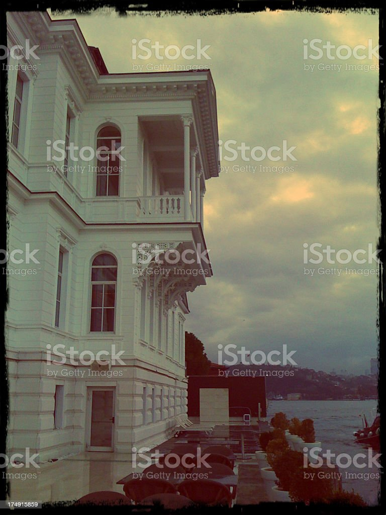 Wooden white waterside residence by sea in Istanbul, Turkey royalty-free stock photo