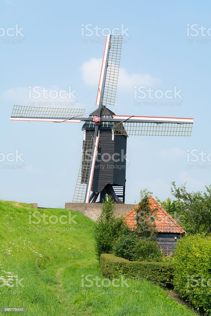 Wooden windmill on fortified city wall Heusen Netherlands stock photo