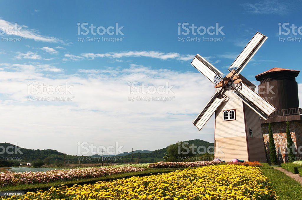 Wooden windmill stock photo