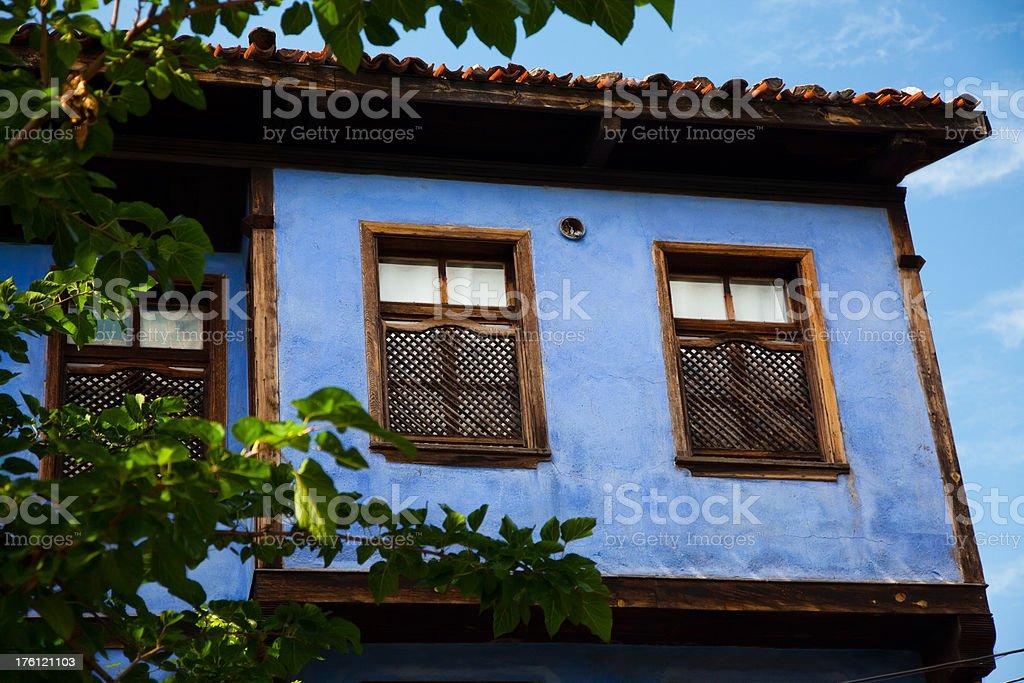 Wooden window on blue painted oriel stock photo