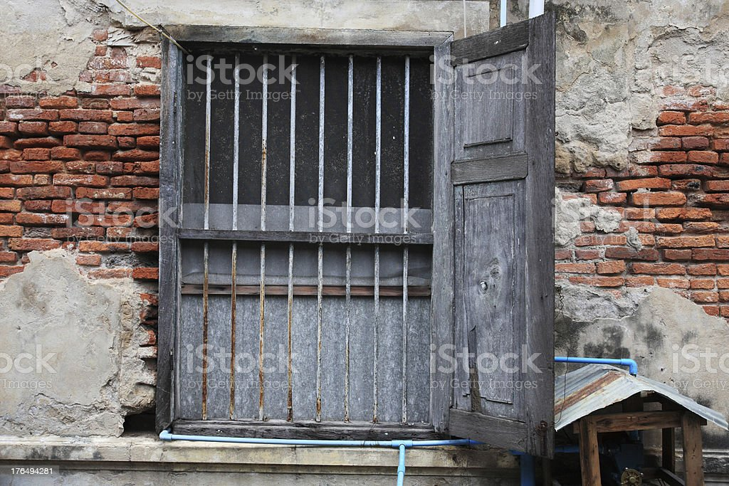 Wooden window on grunge brick wall royalty-free stock photo