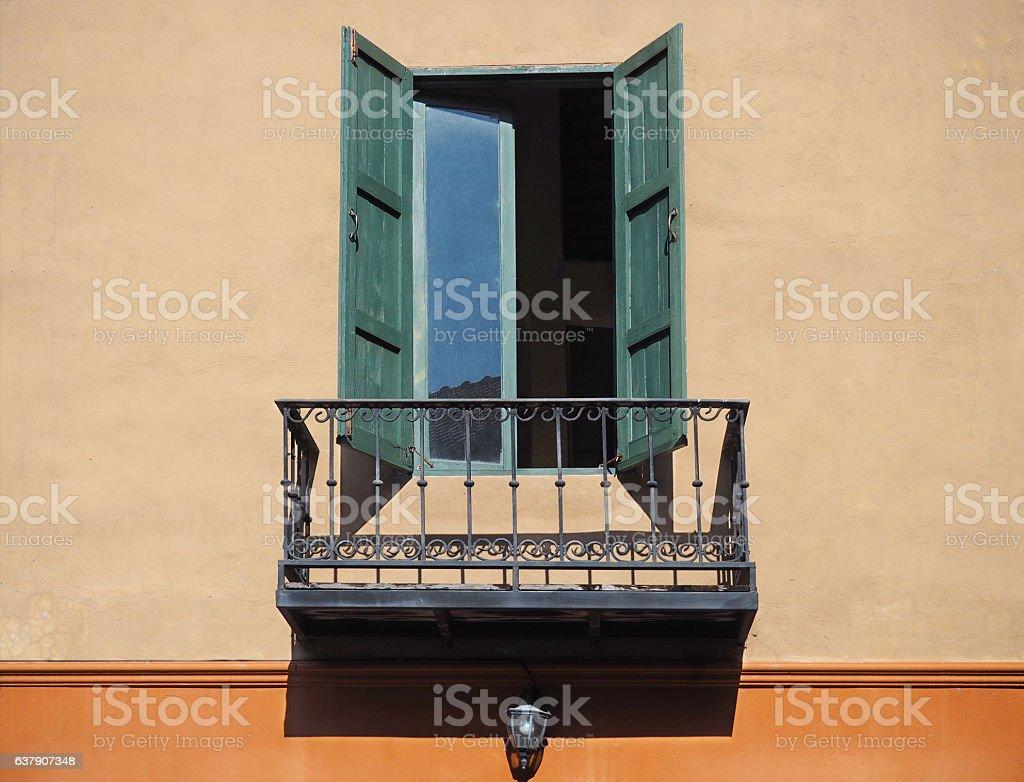 Wooden window on orange wall with balcony stock photo