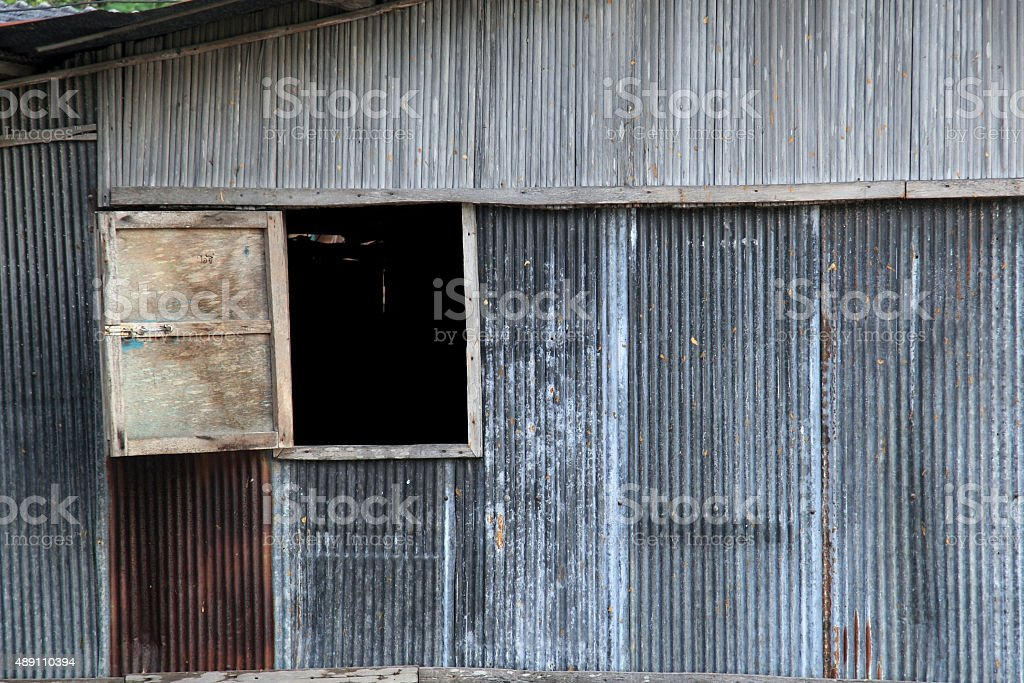 Wooden window on zinc wall of house in countryside stock photo