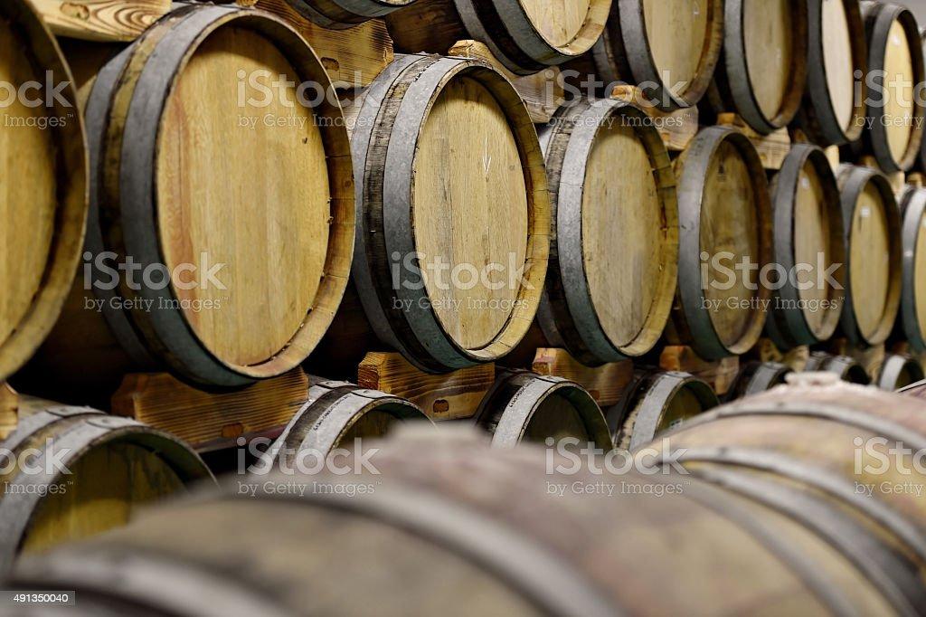 Wooden wine barrels in cellar stock photo