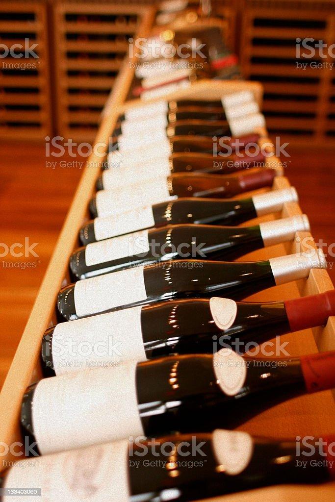 Wooden Wine Rack - Bottles on Side royalty-free stock photo