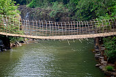 Wooden with bamboo bridge for cross over stream river
