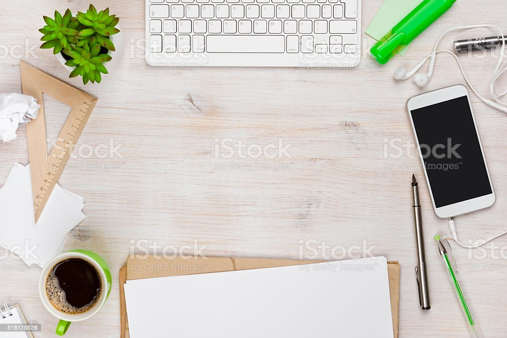 Wooden work desk top view with copyspace in the middle stock photo