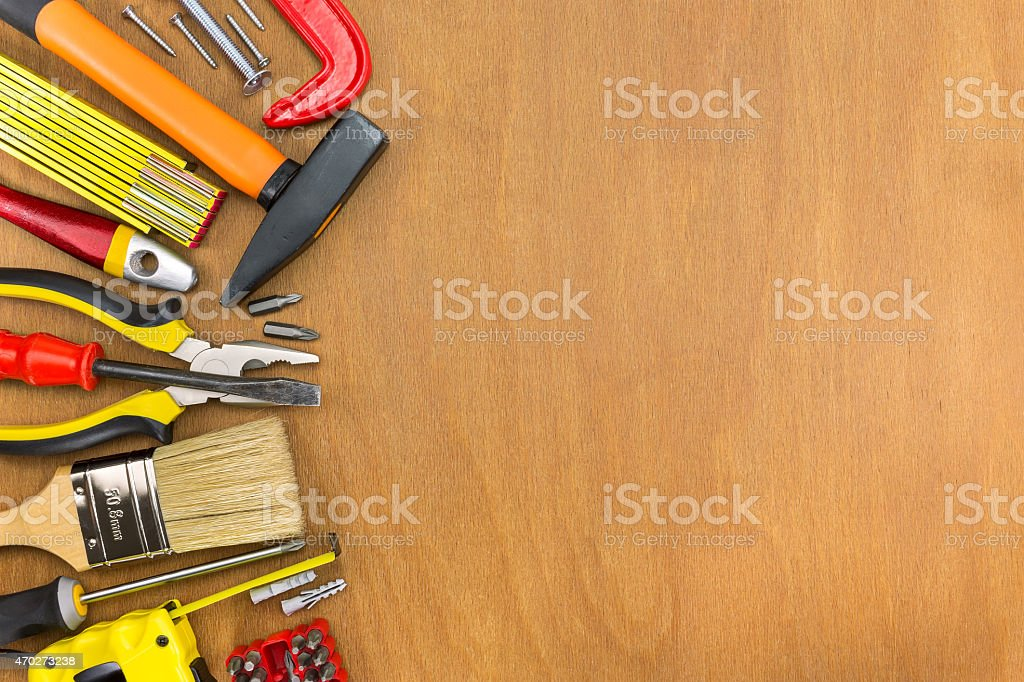 Wooden workshop table with tools stock photo