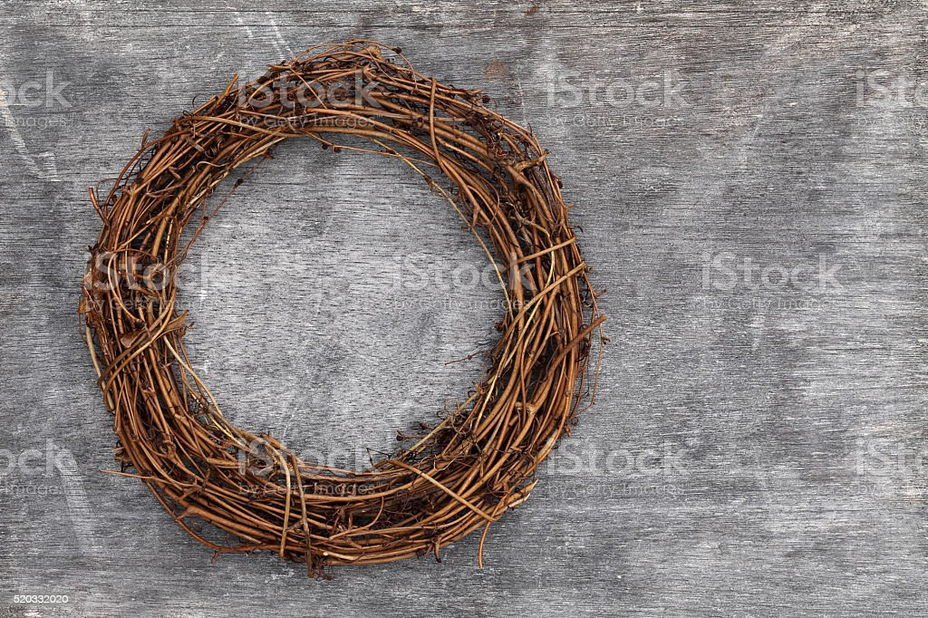 wooden wreath made of dried branch stock photo