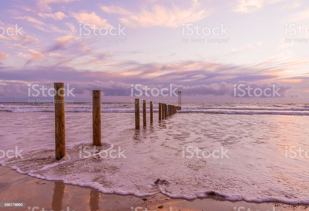 Woodet poles Aldinga silver sand beach sunset stock photo