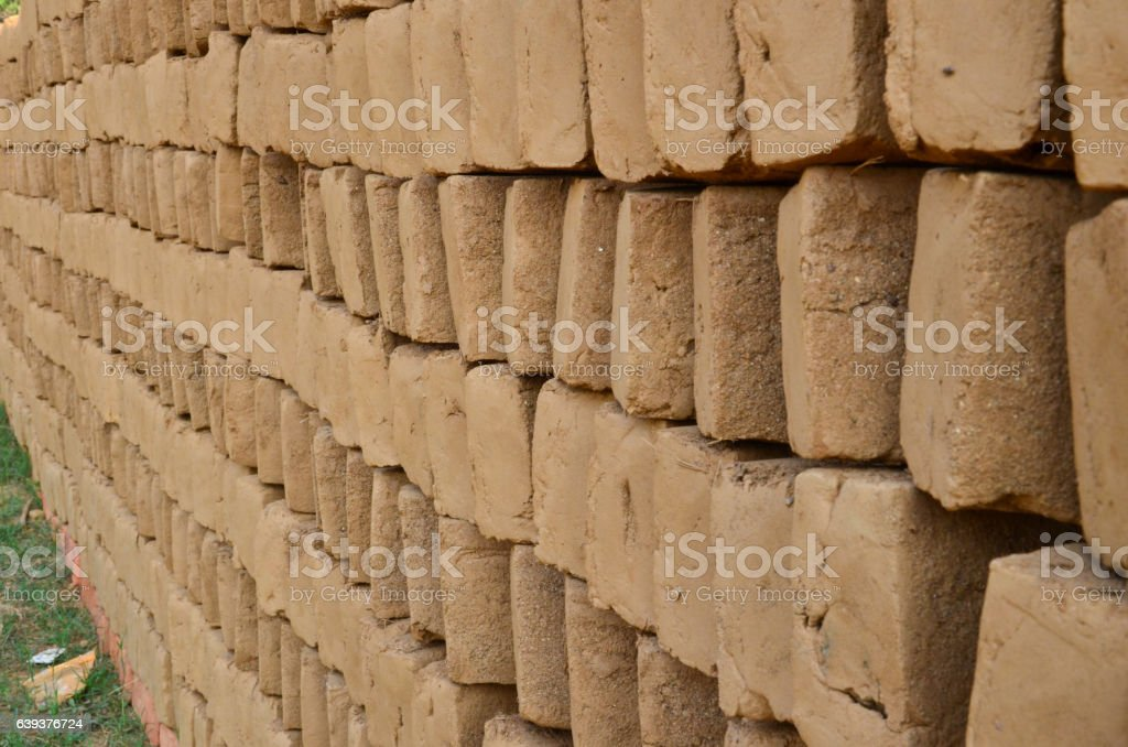 Wood-fired clay brick kiln on the bank of a river stock photo