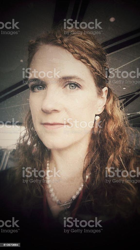 Woodland Elf Braided Curly Hair Angular Chin Female Wearing Pearls stock photo