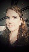 Woodland Elf Braided Curly Hair Angular Chin Female Wearing Pearls