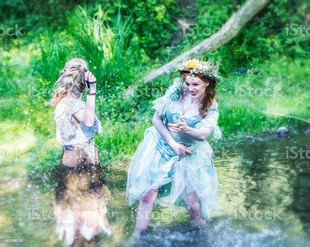 Woodland Fairies Splashing Water In Stream stock photo