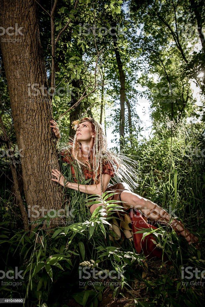 Woodland Princess Hugging Tree stock photo