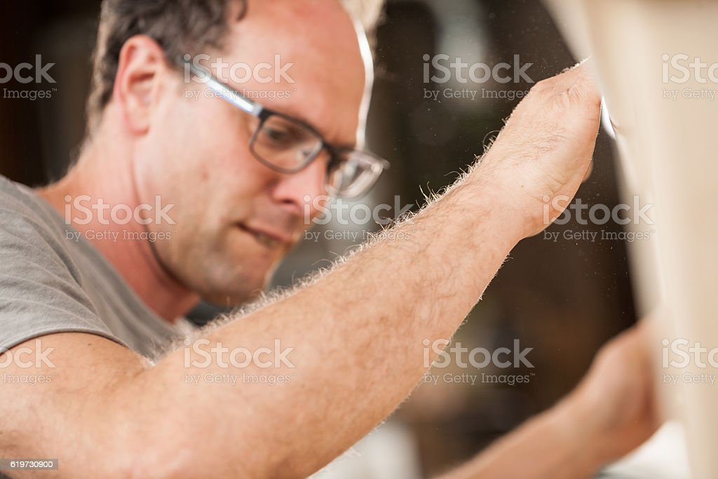 woodmaker working in his shop or lab stock photo