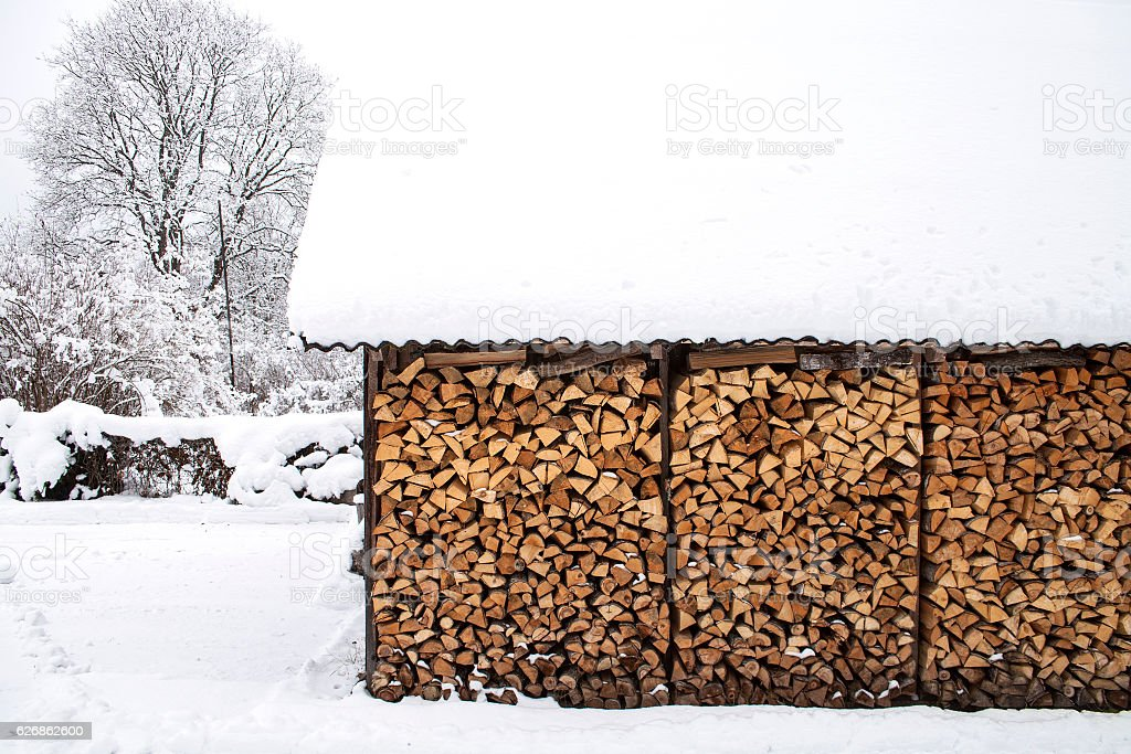 Woodpile of cleaved firewood. stock photo