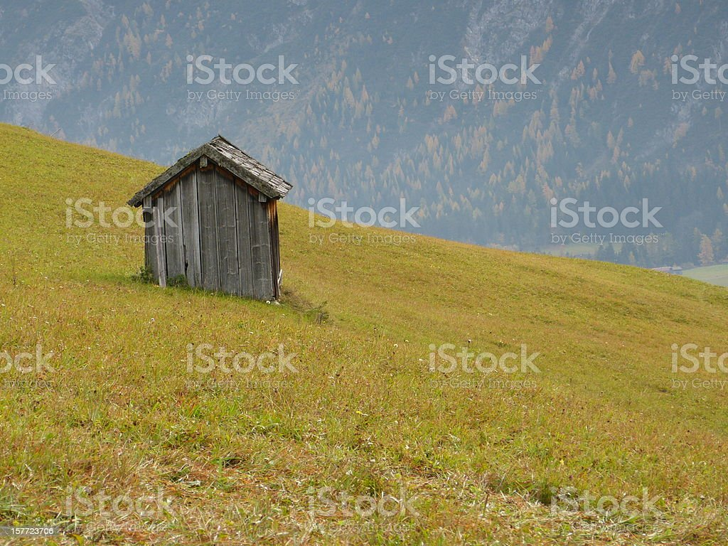 Woodshed on the mountain meadow stock photo