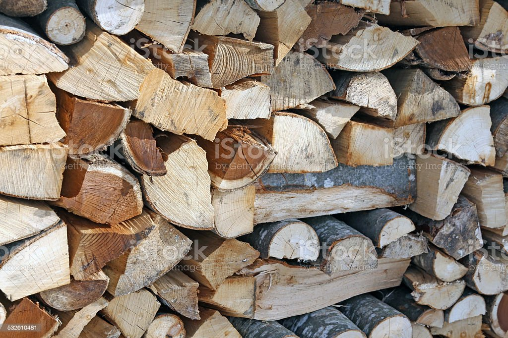 Woodshed with pieces of wood cut stock photo