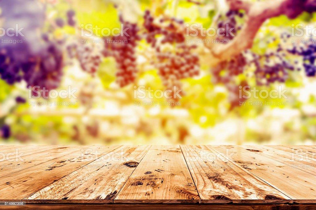 woodtable in vineyard stock photo