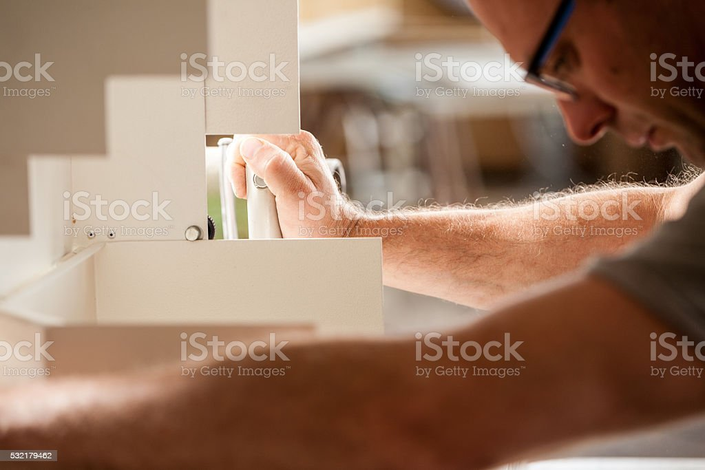 woodworker focused on his job stock photo