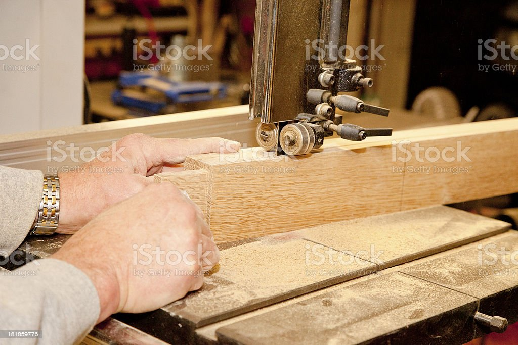 Woodworking - Cutting with a Bandsaw royalty-free stock photo