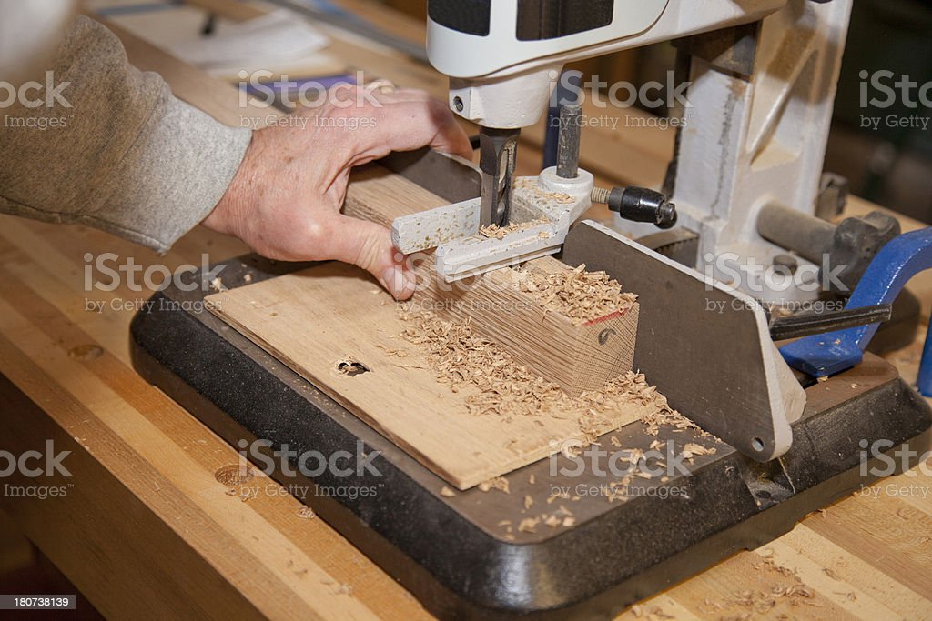 Woodworking - Using a Dedicated Mortising Machine royalty-free stock photo