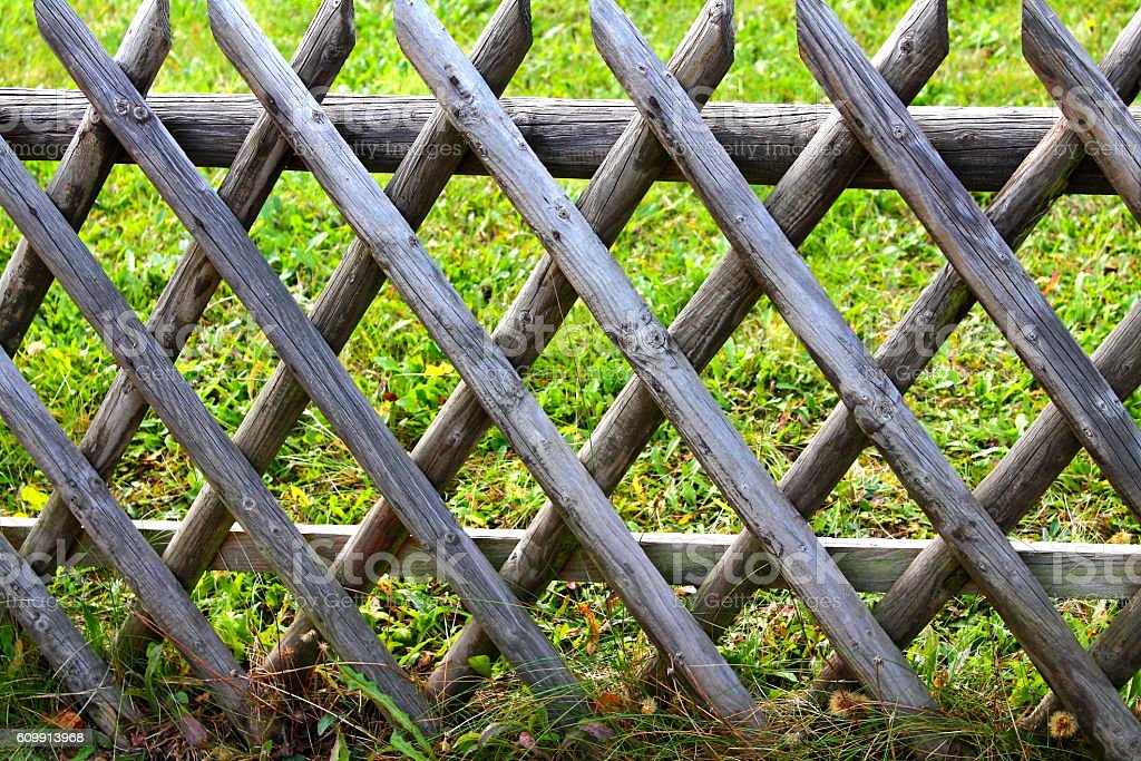 Woody fence. Criss-cross fence. stock photo