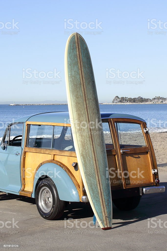 Woody Watching the Waves with Surfboard stock photo