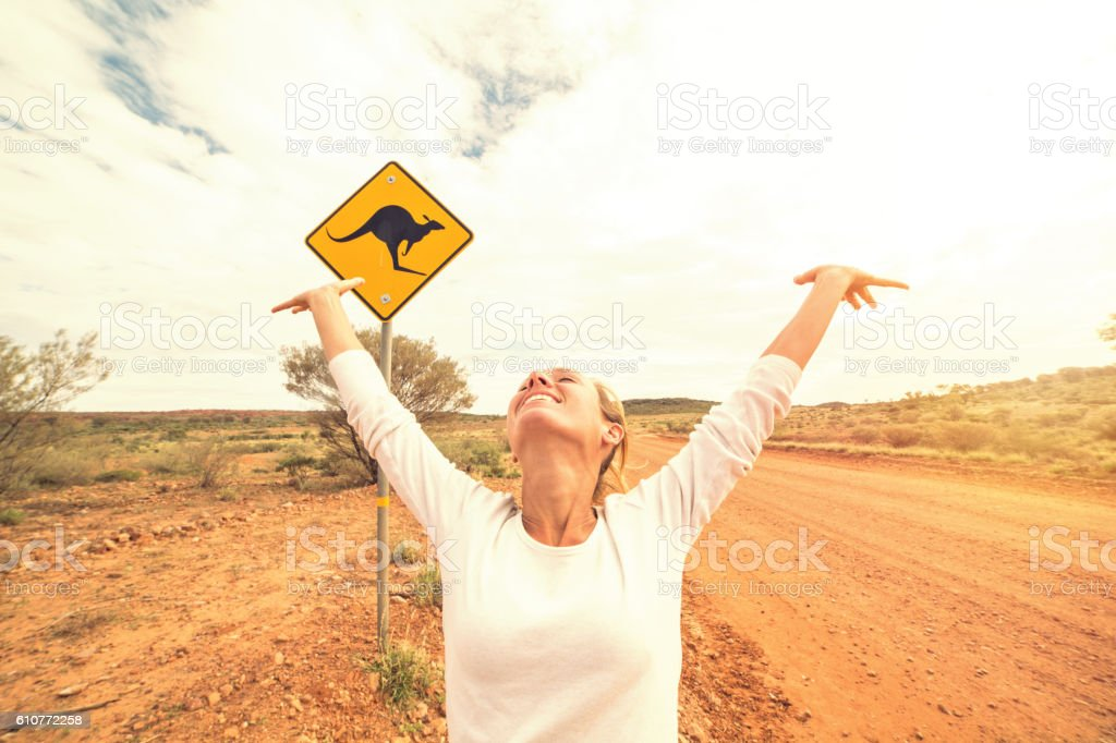 Woohoo! Girl arms outstretched in Australia stock photo