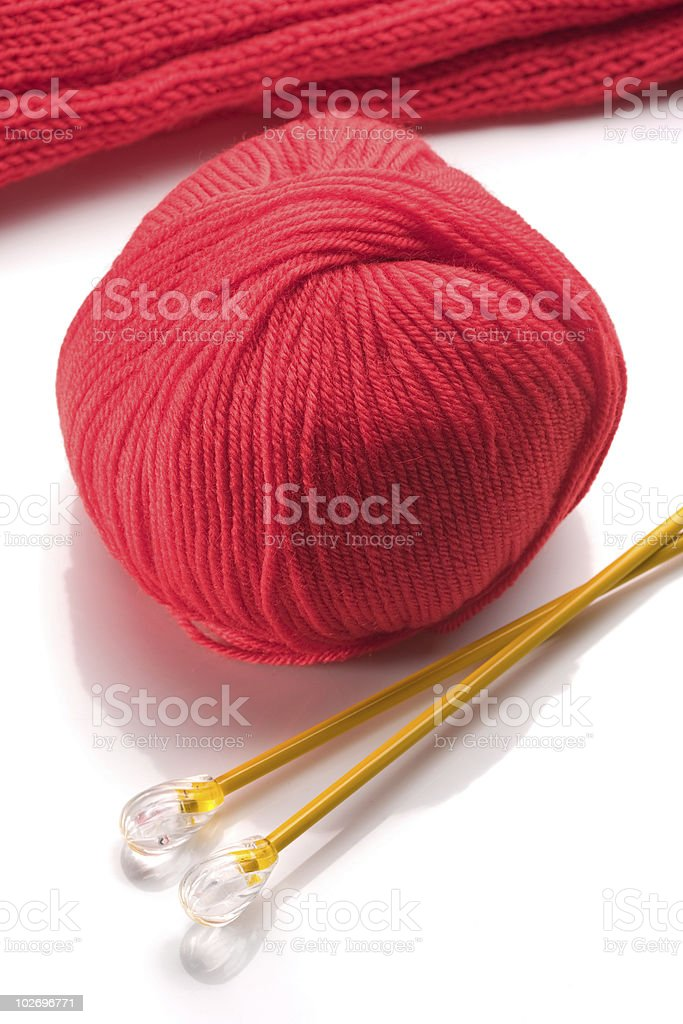 Wool and wooden needles over white background royalty-free stock photo
