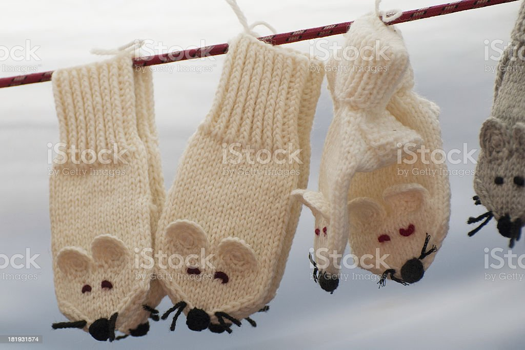 Wool baby mittens hanging on clothesline royalty-free stock photo