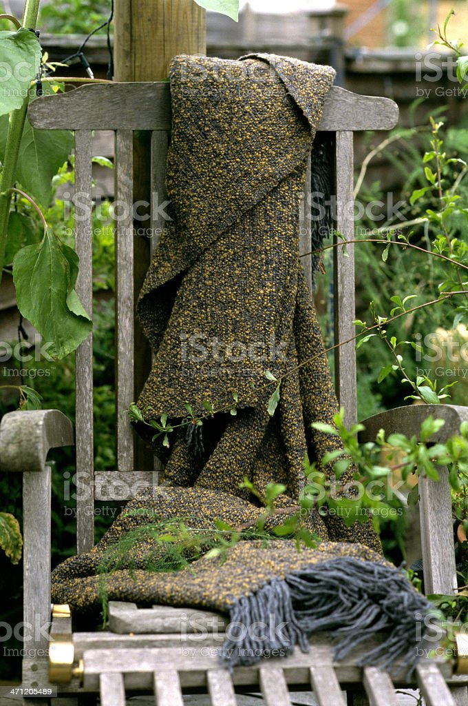 Wool blanket on garden chair royalty-free stock photo