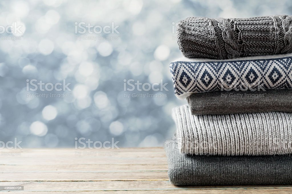 Wool knitted winter clothes sale or discount, space for text stock photo
