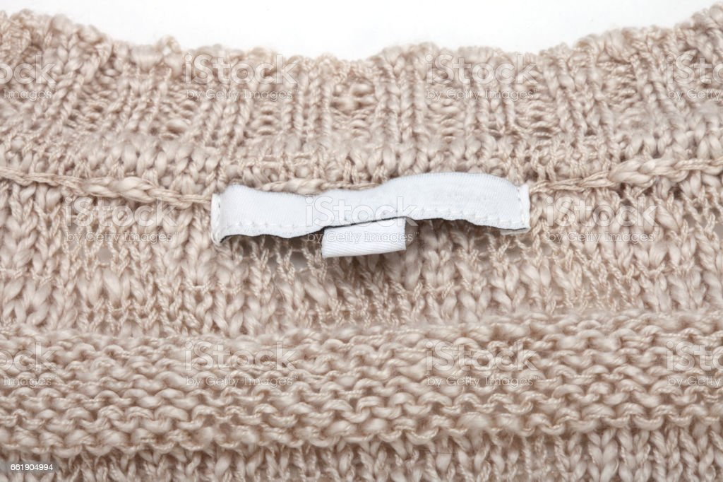 wool knitting sweater texture with empty label stock photo
