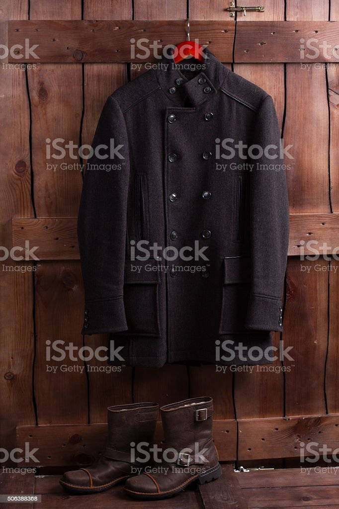 Wool overcoat and leather men's shoes. stock photo