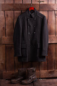 Wool overcoat and leather men's shoes.