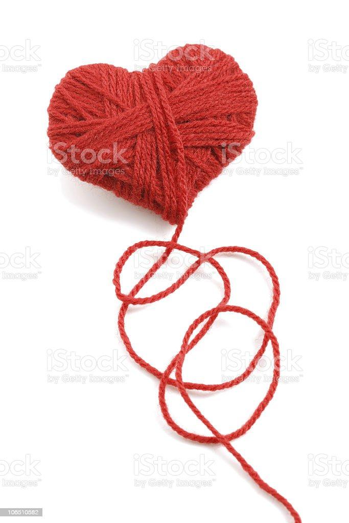 Wool red yarn in a heart shape stock photo