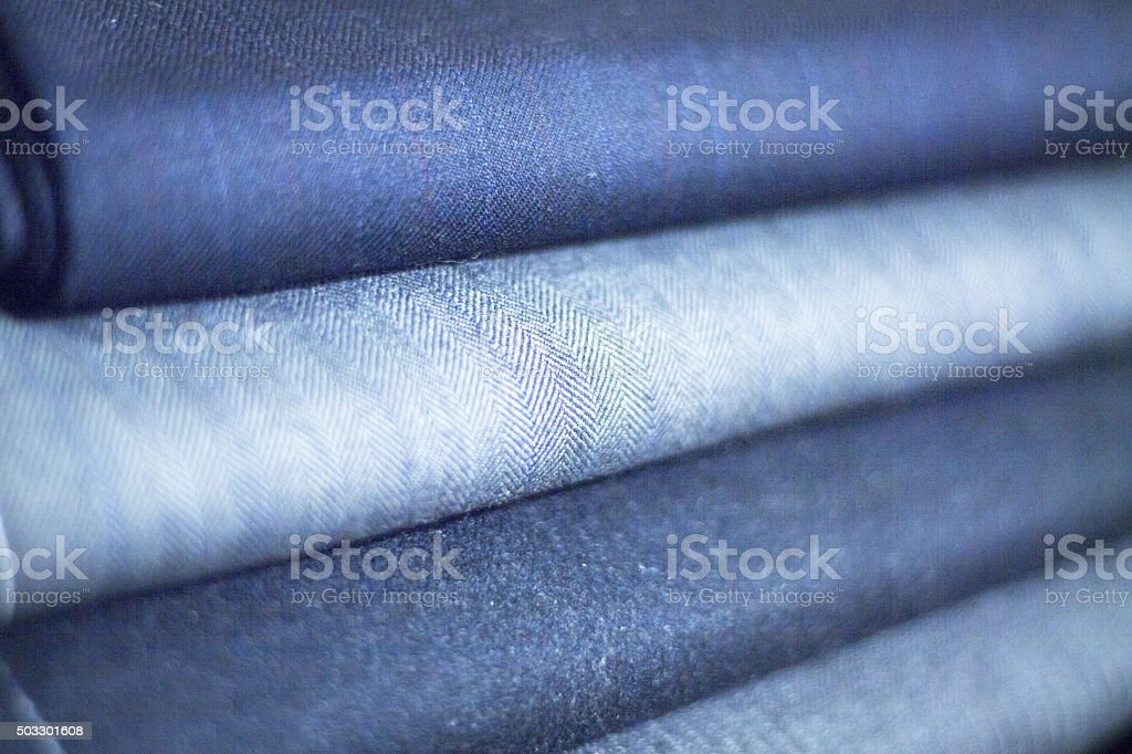 Wool suit cloth in tailors store window stock photo