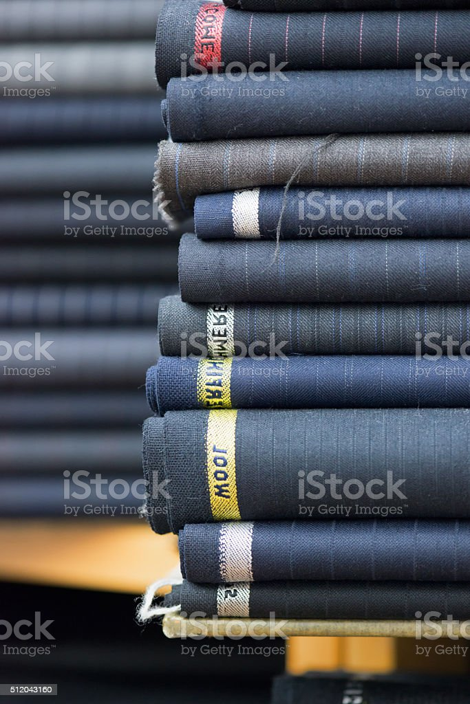 Wool Suit Fabric Bolts in a Hong Kong Tailor Shop stock photo