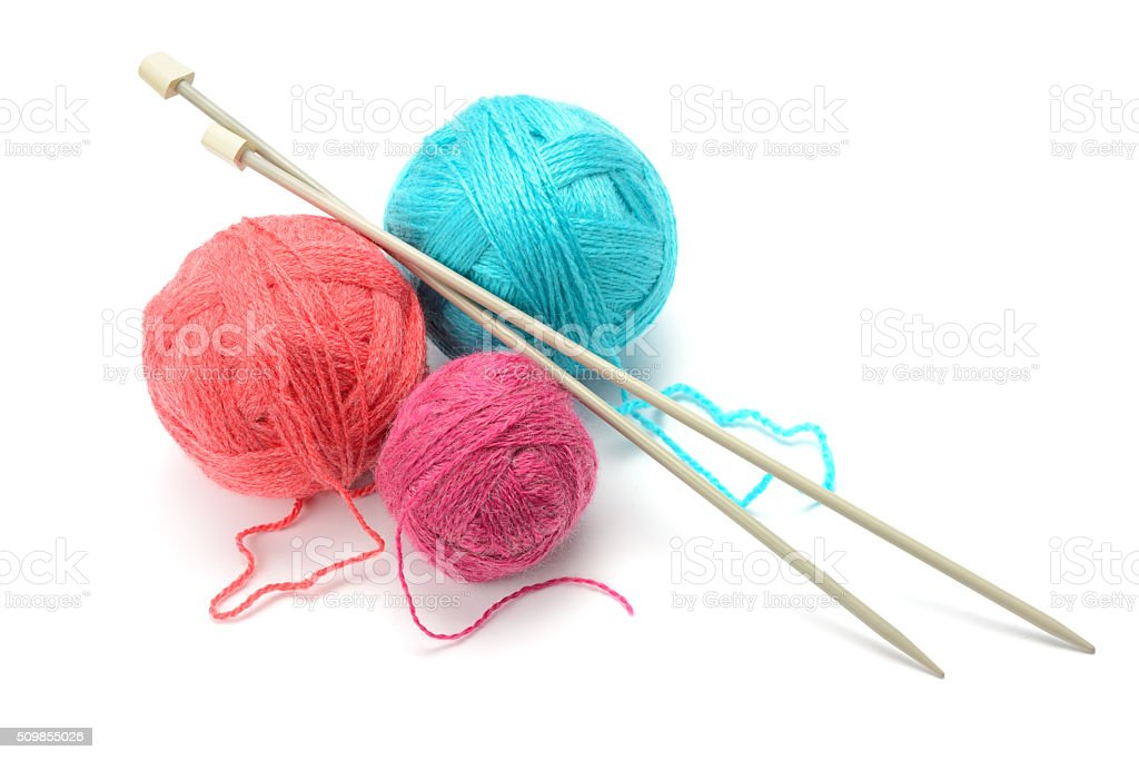 Woolen balls and knitting needles stock photo