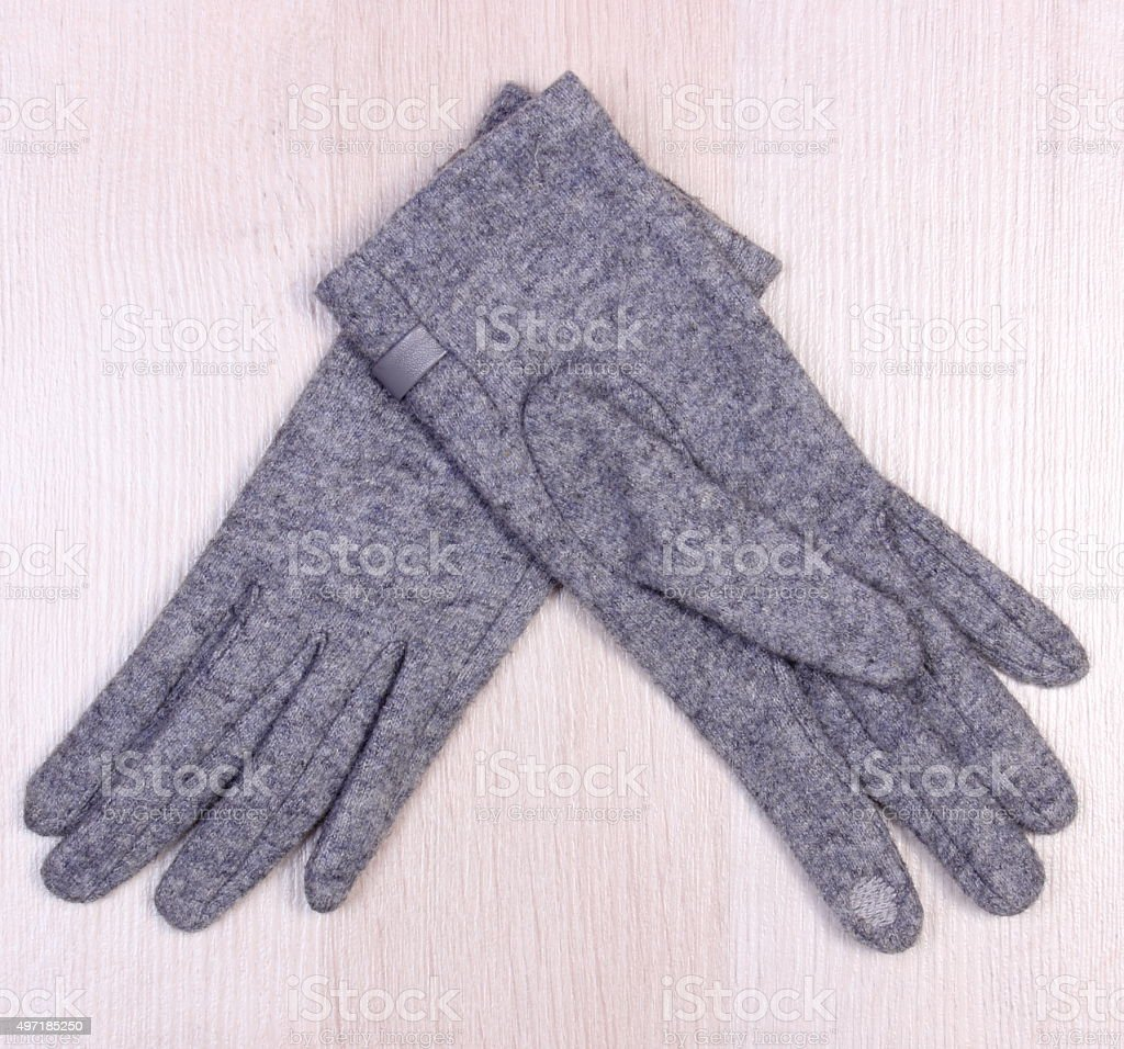 Woolen gloves on wooden background, clothing for autumn or winter stock photo
