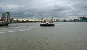 Woolwich ferry crossing over the River Thames