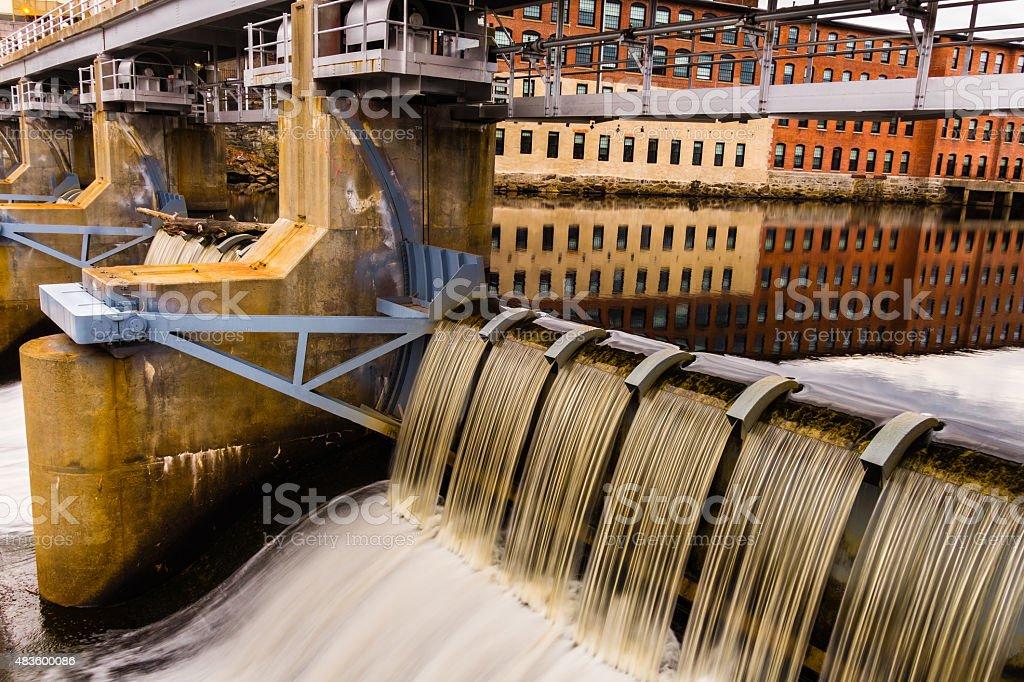 Woonsocket, RI mill and waterfall stock photo