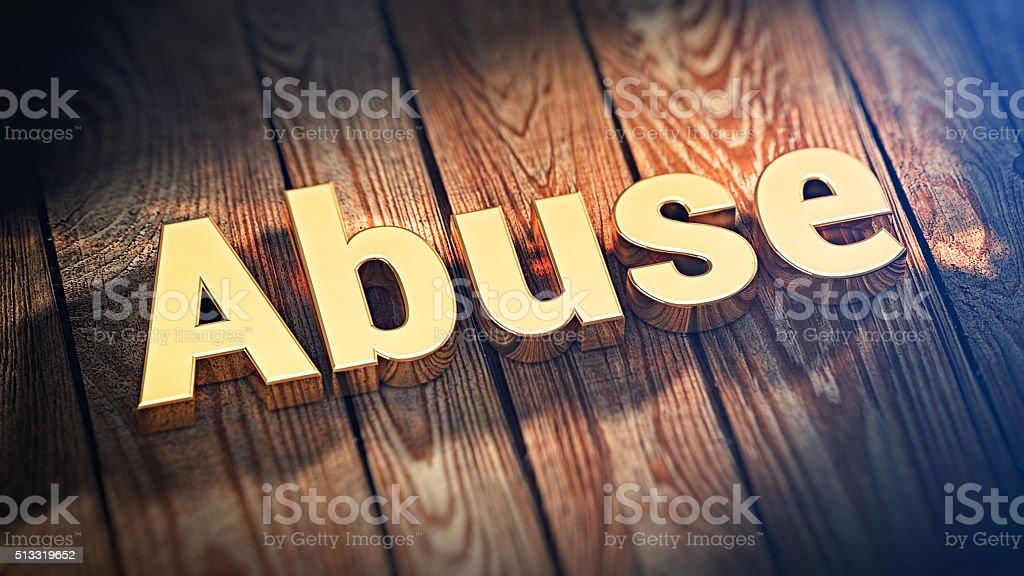 Word Abuse on wood planks stock photo