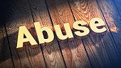 Word Abuse on wood planks