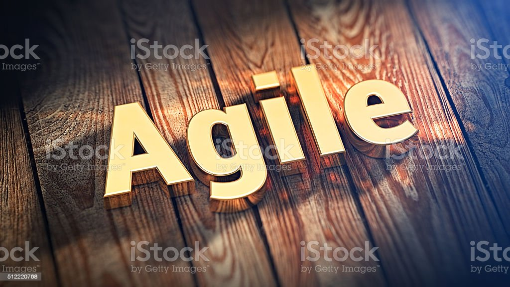 Word Agile on wood planks stock photo