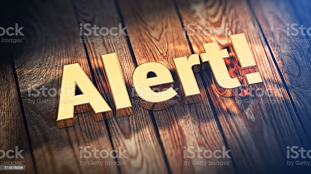 Word Alert! on wood planks stock photo