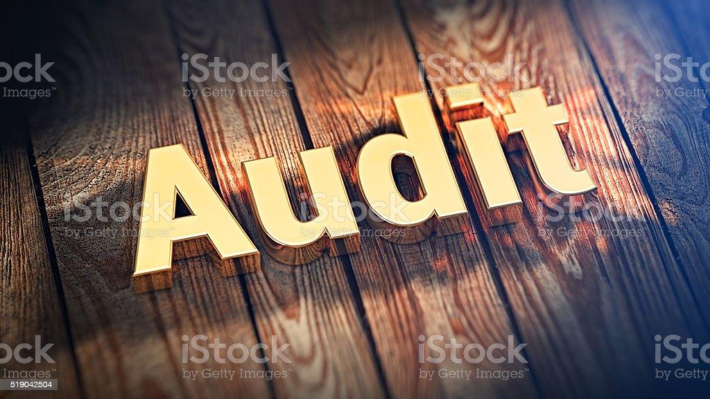 Word Audit on wood planks stock photo